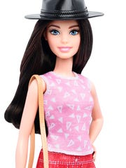 """""""Pizza Pizzazz"""" is a weird name for this pretty, petite Barbie."""