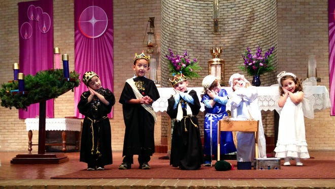 "Our Lady of Prompt Succor School pre-kindergarten students sing ""Away In A Manger"" dressed as the three kings, Mary, Joseph and an angel in a Christmas program Tuesday. The performance featured hand motions like sleeping for the line ""the little Lord Jesus lay down his sweet head."""