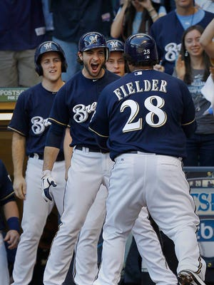 Ryan Braun greets Prince Fielder after he hit a two-run homer during the first game of the 2011 NLCS.