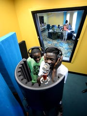 Darius Buchanan, left, and Takelyn Kelly rehearse a song in the new recording studio at the Boys and Girls Club of Green Bay's west-side location.