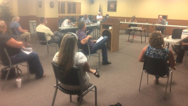 There was limited seating at Thursday night's Reno County Planning Commission hearing on wind regulations due to social distancing. Speakers had to leave after addressing the board so that people in overflow seating on the courthouse's first floor could come in.