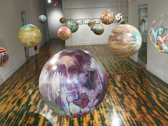 """Dick Termes' hand-painted """"Termespheres"""" are on display"""