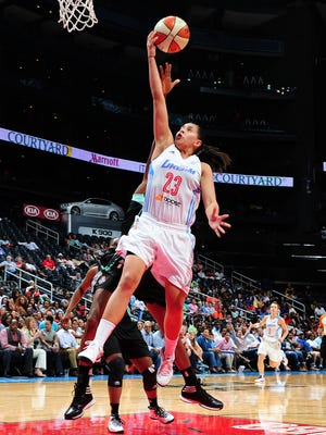 ATLANTA, GA - JUNE 20: Shoni Schimmel #23 of the Atlanta Dream puts up a shot against the New York Liberty on June 20, 2014 at Philips Arena in Atlanta, Georgia.  NOTE TO USER: User expressly acknowledges and agrees that, by downloading and/or using this Photograph, user is consenting to the terms and conditions of the Getty Images License Agreement. Mandatory Copyright Notice: Copyright 2014 NBAE (Photo by Scott Cunningham/NBAE via Getty Images)