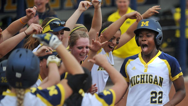 Sierra Lawrence and the Wolverines open Women's College World Series play Thursday night against Alabama.