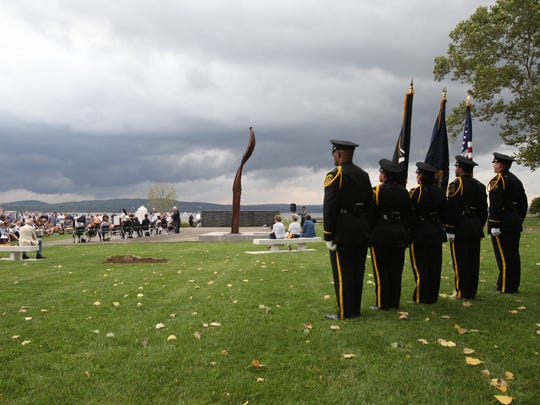 The police honor guard stand at attention during the Rockland County Sept. 11 memorial service at Haverstraw Bay Park in Haverstraw, Sept. 11, 2016.