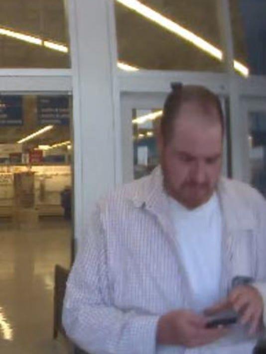 636438410870283304-meijer-phone-suspect.JPG