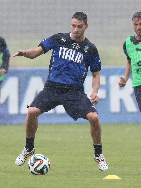 Italy's Mattia De Sciglio controls the ball during a training session in the rain, in Mangaratiba, Brazil, Tuesday, June 10, 2014. Italy will play in group D of the Brazil 2014 soccer World Cup. (AP Photo/Antonio Calanni)