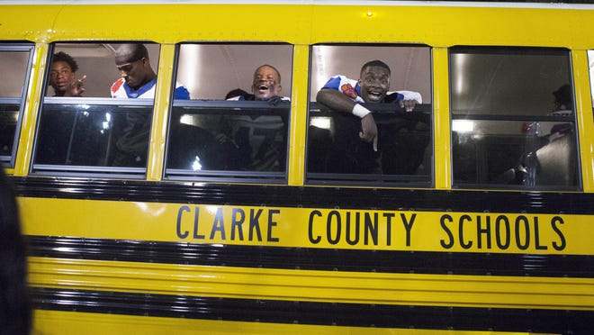 The Cedar Shoals Jaguars celebrate after boarding their bus after a high school football game between Clarke Central and Cedar Shoals at Clarke Central High School in Athens, Georgia, on Friday, September 28, 2018. Cedar Shoals beat Clarke Central for the first time in 10 years with a score of 7-17.