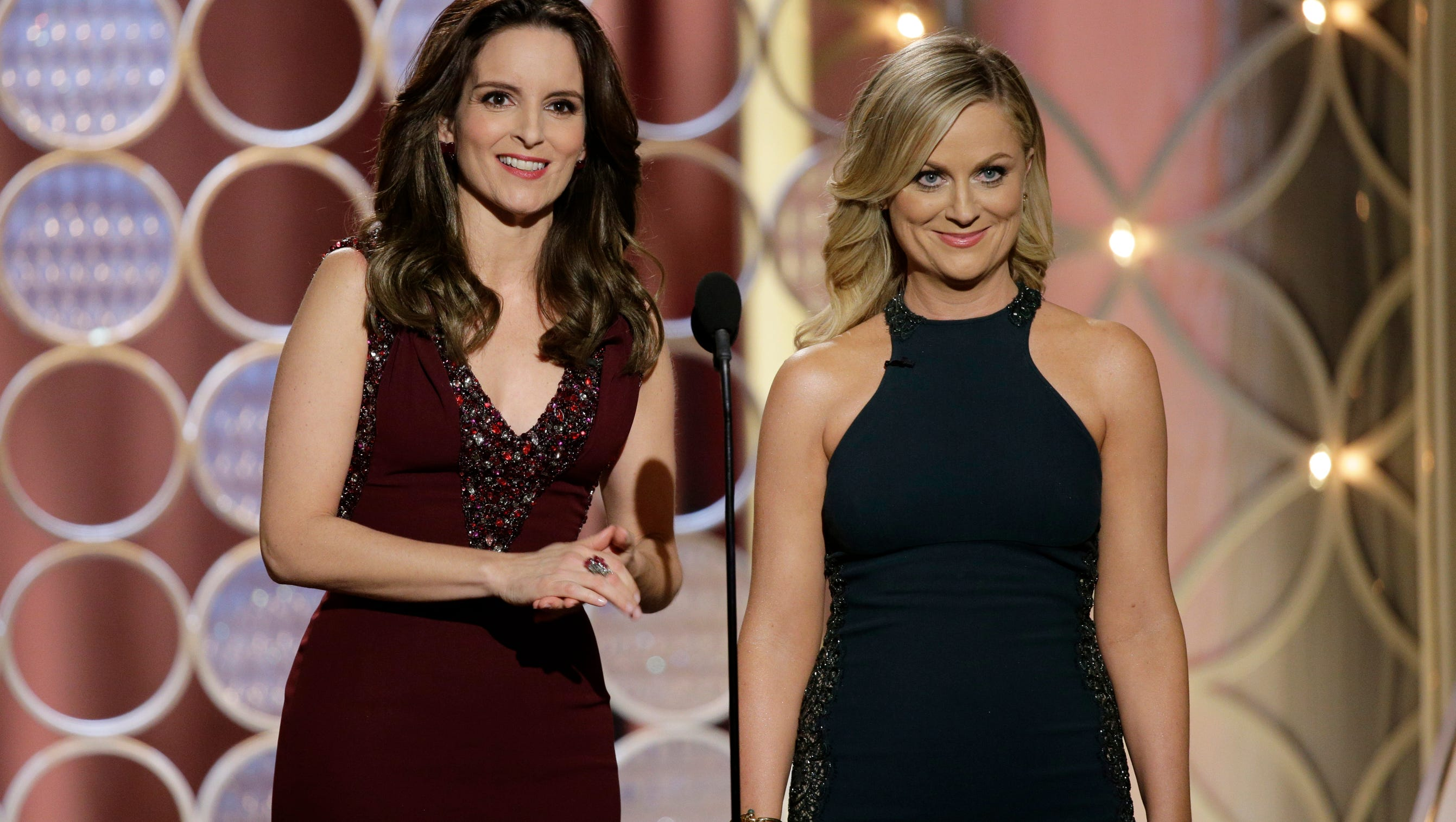 Tina Fey, left, and Amy Poehler have been big hits as Golden Globes hosts.