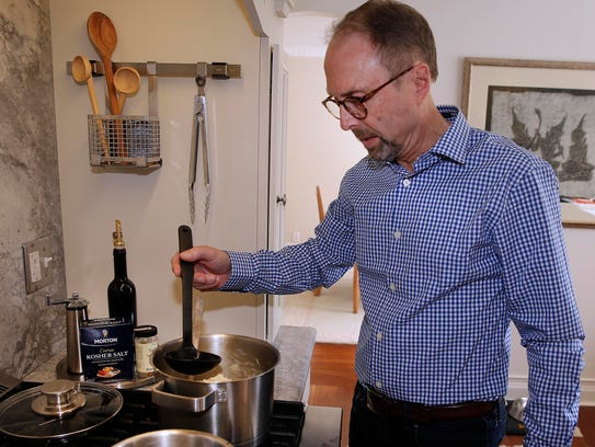 Paul Sienkiewicz adds broth by the ladleful to his
