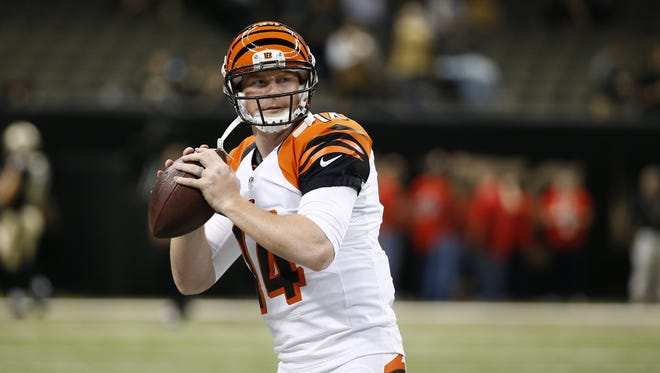 Cincinnati Bengals quarterback Andy Dalton (14)warms up during pre game against the New Orleans Saints at the Superdome in New Orleans.
