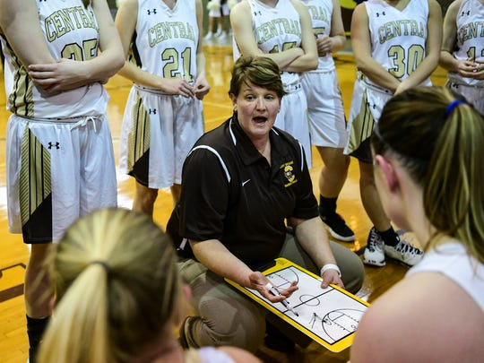 Central Head Coach Michelle Harter talks to her team during a fourth quarter timeout in the Class 4A first round sectional match against the Reitz Panthers at Central High School in Evansville, Ind., Tuesday, Jan. 30, 2018. The Bears defeated the Panthers, 42-27.