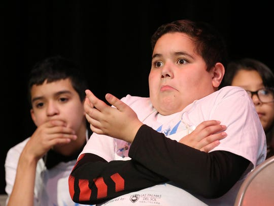 David Chavez, representing Alicia R. Chacon International School, reacts to the incorrect spelling of a word by another speller during the opening day of the 2016 El Paso Times Spelling Bee, which was held Thursday afternoon at Bel Air High School's Tartan Theatre.