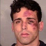 Joey Kadmiri poses for a booking photo at the Las Vegas Police Department released on March 19, 2014. He is accused of firing a gun near the head of a performer in the Thunder From Down Under male revue during a backstage robbery attempt.