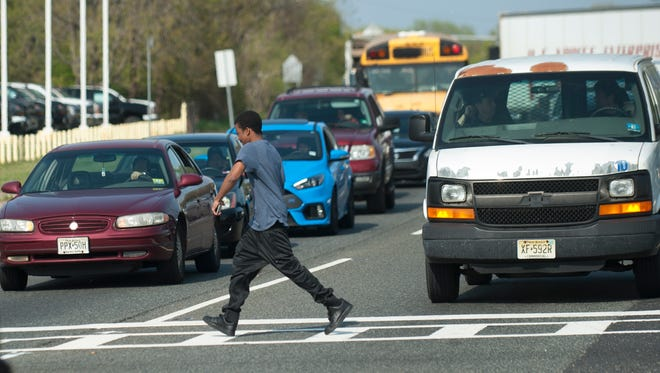 A pedestrian safely crosses Route 130 South in Burlington County