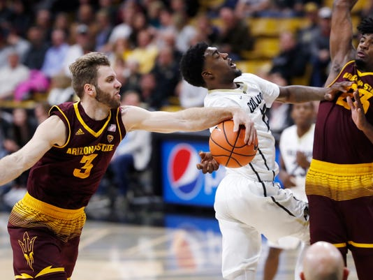 Colorado guard Namon Wright, center, is stripped of the ball by Arizona State forward Mickey Mitchell, left, as forward Romello White defends during the second half of an NCAA college basketball game Thursday, Jan. 4, 2018, in Boulder, Colo. Colorado won 90-81 in overtime. (AP Photo/David Zalubowski)