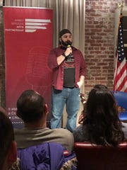 Michael Carrasquillo performs stand-up comedy at Dog Tag Bakery in Georgetown in Washington, D.C. He isn't afraid to discuss his combat experience.