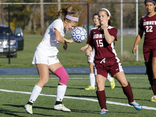 Notre Dame's Emma Booth heads the ball in front of Sidney's Cassie O'Hara during a Section 4 Class C girls soccer quarterfinal Friday at Brewer Memorial Stadium.