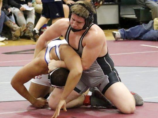 Elmira's Matt Burge, top, wrestles Horseheads' LaDarron