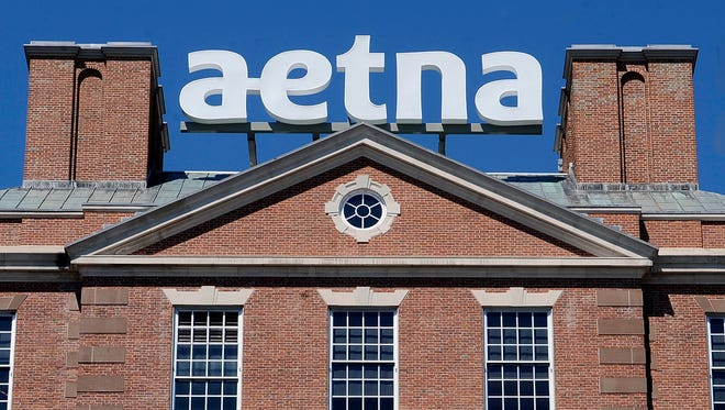 In this Aug. 19, 2014, file photo, a sign stands at Aetna headquarters in Hartford, Conn.