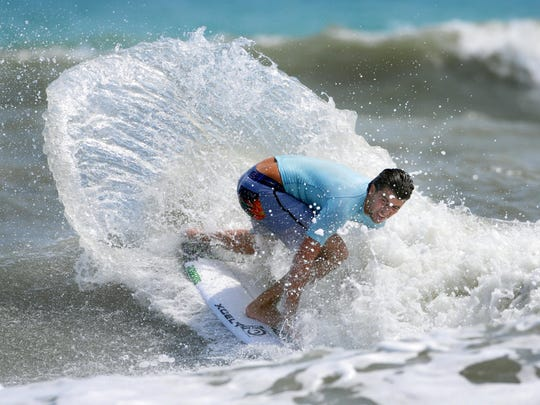 Tyler Thornsley of Cape Canaveral cuts back on a nice wave during the men's short board final during the 52nd annual Easter Surf festival held at Lori Wilson Park in Cocoa Beach.