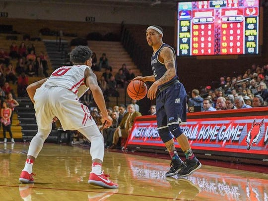 Monmouth's Justin Robinson works against a Marist defender