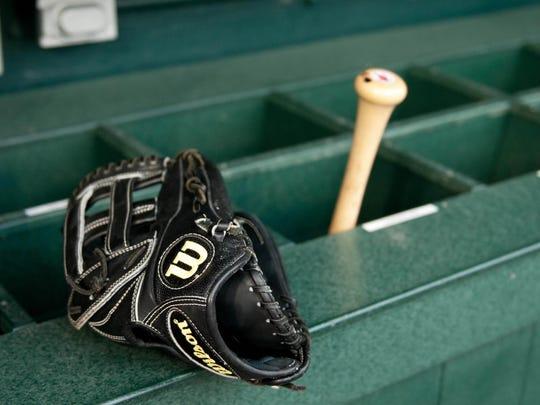 Baseball bat and glove.
