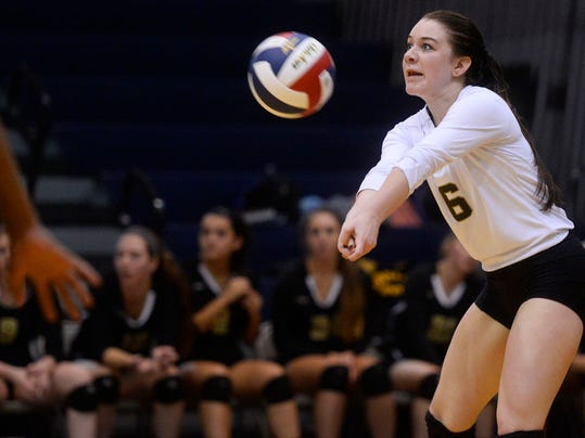 Delone Catholic's Lexi Shanabrook bumps the ball during the YAIAA girls' volleyball tournament championship game at Dallastown Area High School on Tuesday.