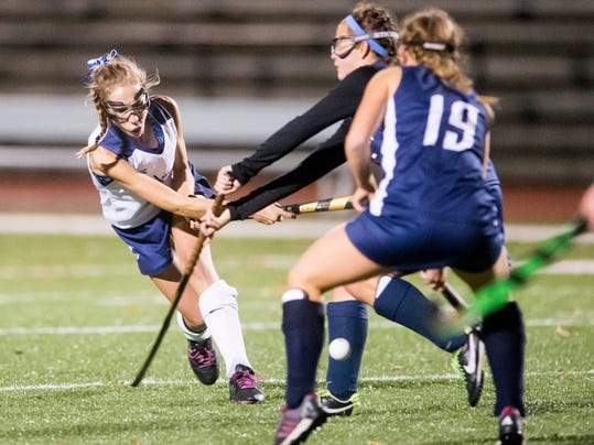Dallastown's Lydia Trout (48) advances the ball upfield past the Manheim Township defense in a District 3 Class AAA field hockey tournament game at Dover Area High School on Thursday. The Wildcats won 1-0.