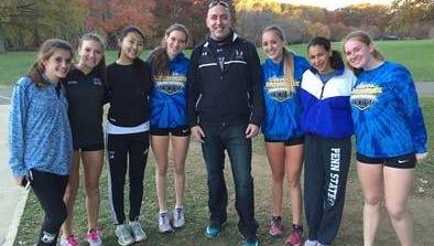 NV/Demarest girls cross-country team (from left) Lola Gueguen, Harley Nickl, Maddy Song, Georgia Markham, coach Brendan Kenny, Leah Woods-Bannan, Emily Cohen, Liza Pilsbury.