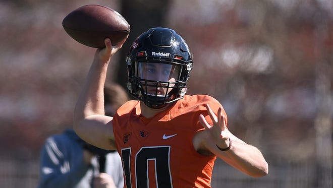 Oregon State Beavers quarterback Darell Garretson throws a pass during spring NCAA college football practice in Corvallis, Ore. After last season's quarterback carousel at Oregon State, Darell Garretson heads into this season as the established starter.