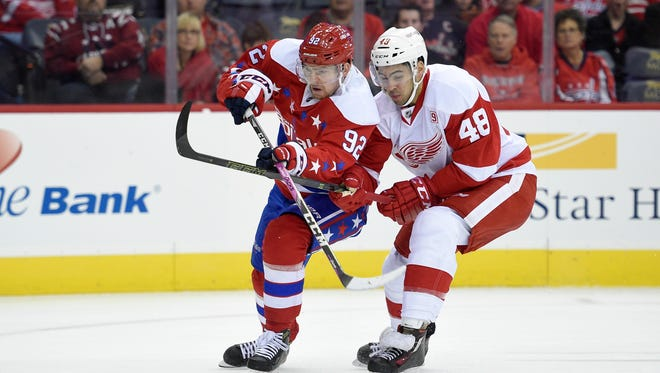 Washington Capitals center Evgeny Kuznetsov battles for the ball against Red Wings defenseman Ryan Sproul (48) during the first period Friday in Washington.