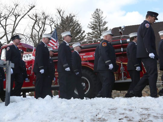 FDNY firefighters stand in honor during the funeral