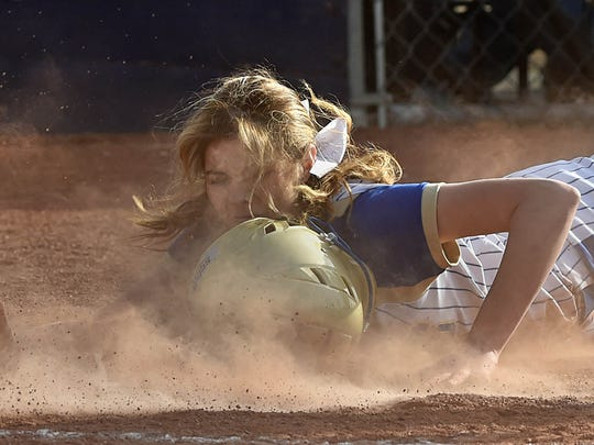 Reed's Maci Abrott drives into home against Damonte Ranch to make it 6-0 in the 5th inning in Thursday's game at Reed.
