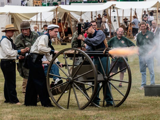 Civil War re-enactors fire a Gatling gun during Heritage