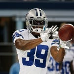 Cowboys' Carr focused on game after mom's death