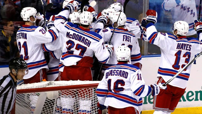 New York Rangers celebrate their win over the Florida Panthers on a goal by left wing Rick Nash in overtime at BB&T Center. The Rangers won 5-4.