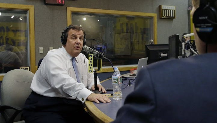 Gov. Chris Christie sits in a studio during his radio