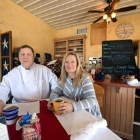 Chef and co-owner Ken Hendrickson, left, sits in the dining room of the now-closed Bellevue location of the Mustard Seed Cafe with his wife and co-owner Patty Hendrickson.