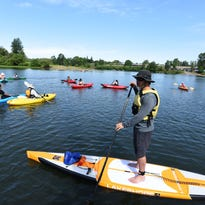 The Straub Environmental Learning Center, which set up this kayaking event to help local high school students feel comfortable on the water, received a $2,000 grant from the William S. Walton Trust.
