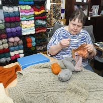 Handmade: Knitter is guided by Braille and technology