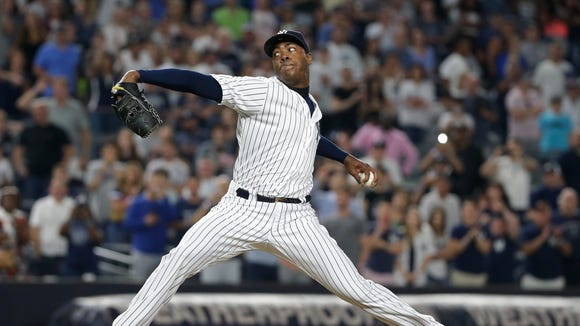 New York Yankees' Aroldis Chapman delivers a pitch during the ninth inning of the Yankees' baseball game against the Minnesota Twins on Friday, June 24, 2016, in New York. The Yankees won 5-3.