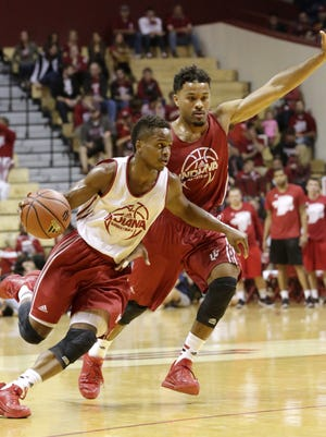 Indiana guard Yogi Ferrell, left, works past guard James Blackmon Jr. in a scrimmage during IU's Hoosier Hysteria on Saturday, Oct. 24, 2015, at Assembly Hall in Bloomington. (James Brosher / For The Star)