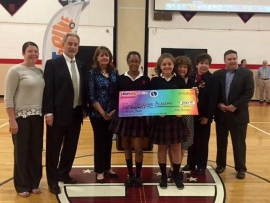 Ursuline Academy received a $100 for placing third in Delaware's Prom Promise Initiative: from left, Amanda Williams (moderator), Pete and Susan Booker from SmartDrive Association, Midori Lofton '16, Jenna Awad '16, Tammie Sylvia (moderator), Principal Carolyn Zogby and Dan Lacey from State Farm Insurance.