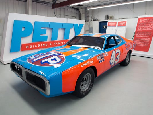 """This 2018 photo provided by Julien's Auctions shows the 1974 Dodge Charger that Richard Petty drove to win his fifth Daytona 500 auto race, at the Richard Petty Museum in Randleman, N.C. Petty's iconic 1974 Dodge Charger is going on sale, along with some of his other cars, one of his Daytona 500 trophies and other items. Petty says after """"accumulating stuff"""" for 80 years, it's time to sell the items at an auction on May 12 at Planet Hollywood in Las Vegas. (Julien's Auctions via AP)"""