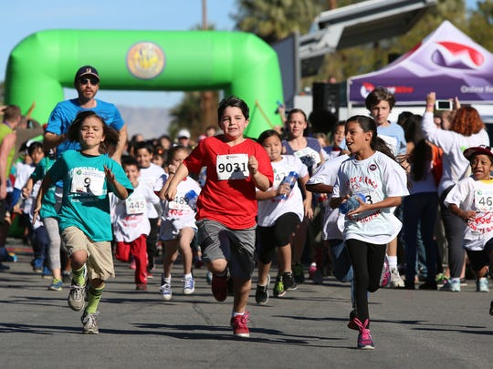 Kids take off running from the Wellness Park in Palm Springs during the Mayor's Healthy Planet Healthy You Kids 1K Fun Run on Saturday.
