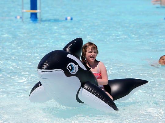 Mikayla Truett cools off in Sunlite Pool at Coney Island.