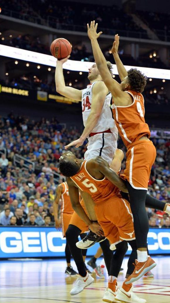Texas Tech Red Raiders forward Matthew Temple (34) shoots and draws a foul from Texas Longhorns guard Kendal Yancy (5) in the first half during the Big 12 Championship Tournament at Sprint Center. Mandatory