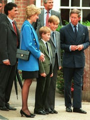 Prince Charles, right, and Princess Diana flanked their