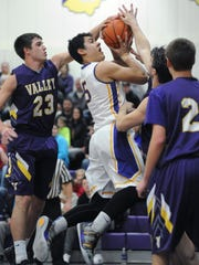 Unioto's Erique Hosley attempts to shoot through traffic against Lucasville Valley in the first half of Tuesday's game at Unioto High School.